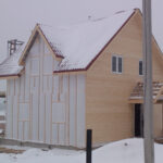 Wooden frame house. Finish of wooden frame by imitation of the building timber
